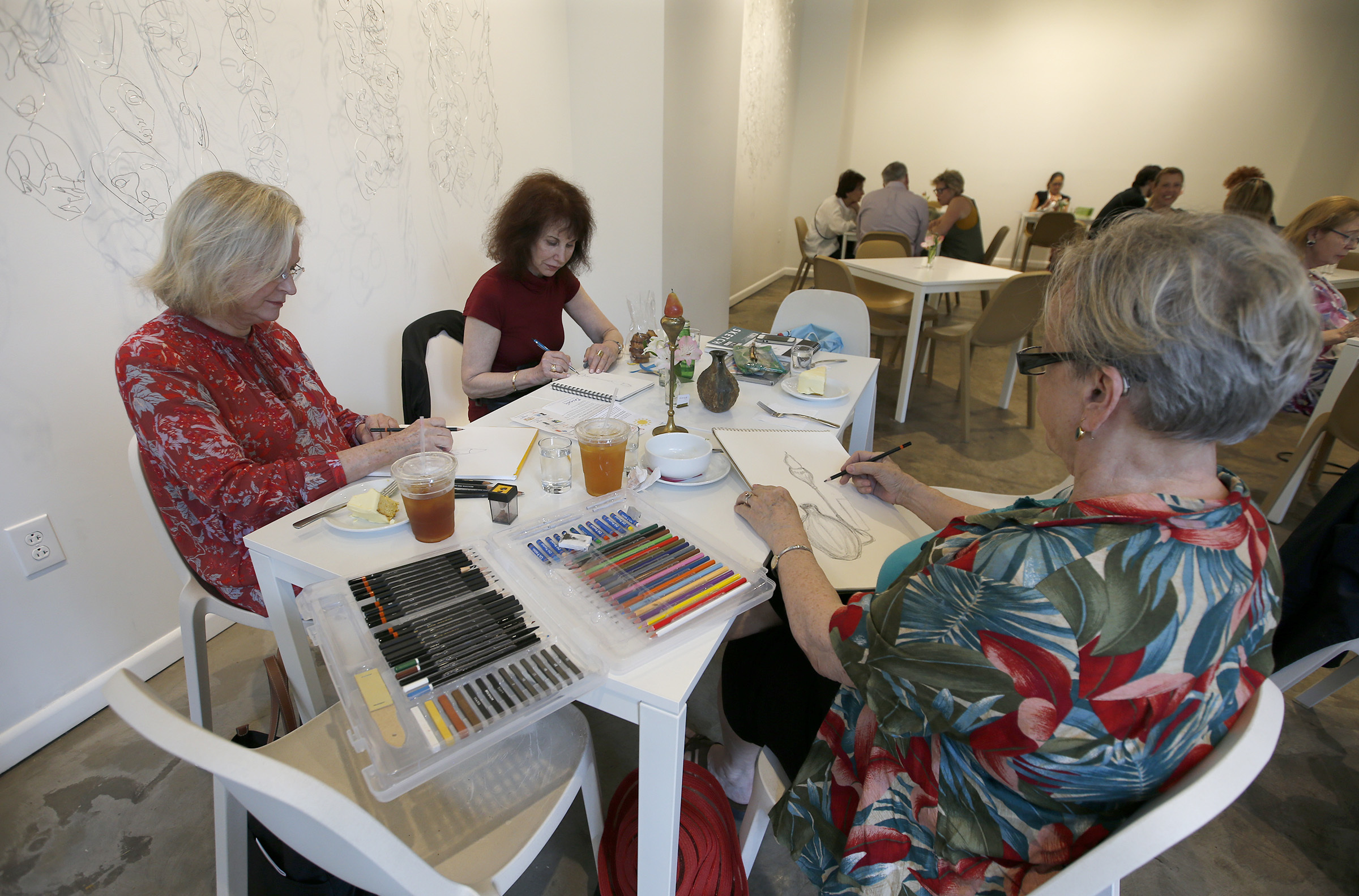 From Left to right: Gay Walling, Ruth Miller and Carole Mablekos sketch and snack at FRIEDA on the 300 block of Walnut Street on Thursday, May 18, 2017. YONG KIM / Staff Photographer