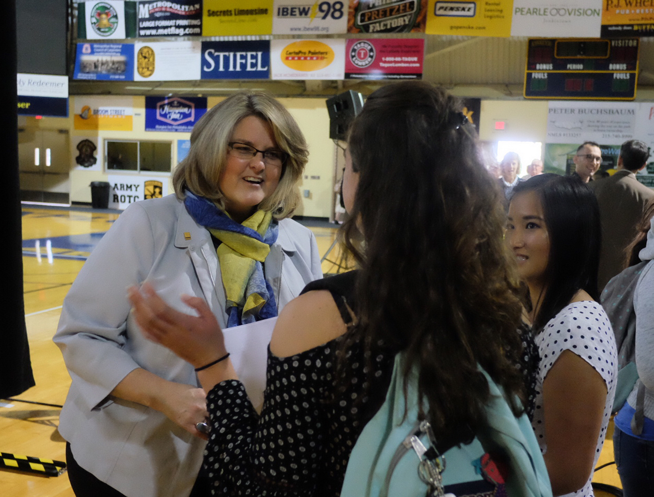 Tuesday September 27, 2016 LaSalle University president Colleen Hanycz happily greets juniors Marissa Beaver , , center, and Emily Paynter, right after announcing a tuition reset Tuesday. Ed Hille / Staff Photographer