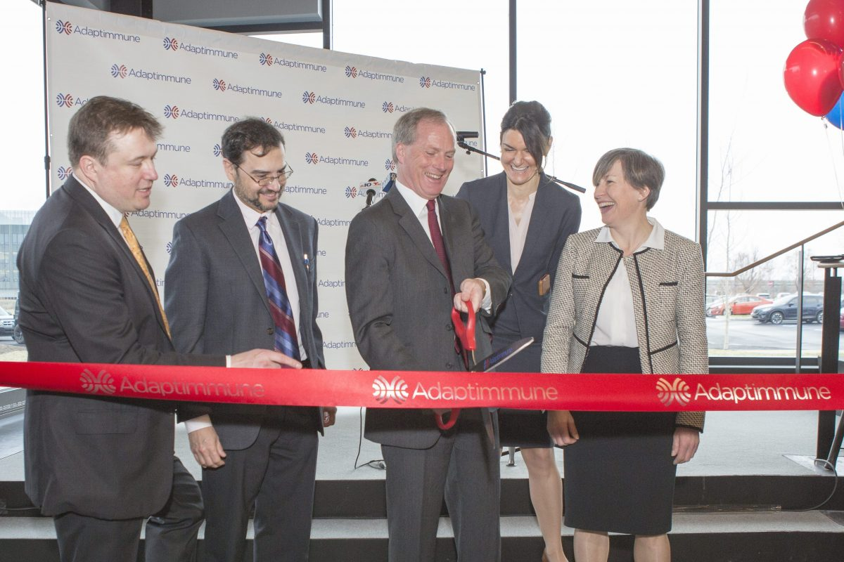 Adaptimmune headquarters ribbon-cutting ceremony at the Navy Yard. Left to right: Adrian Rawcliffe, chief financial officer; Rafael Amado, chief medical officer; James Noble, chief executive officer; Gwen Binder-Scholl, chief technology officer; and Helen Tayton-Martin, chief business officer and company cofounder.