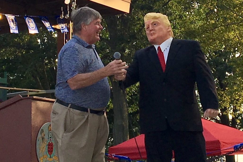 Philadelphia Republican City Committee Chairman Michael Meehan (left) welcomes a President Trump impersonator to the stage at the party's annual Billy Meehan Clam Bake on Aug. 27.