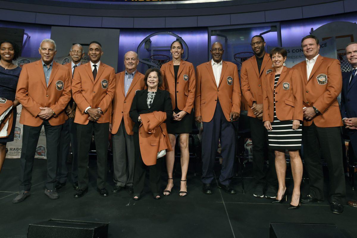 The 2017 class of inductees into the Basketball Hall of Fame, from the left, Lauren Meyers, accepting on behalf of her late great uncle Zack Clayton, Nick Galis, Robert Hughes, Mannie Jackson, Tom Jernstedt, Thelma Krause, accepting on behalf her late husband Jerry Krause, Rebecca Lobo, George McGinnis, Tracy McGrady, Muffet McGraw, Bill Self, and Naismith Hall of Fame President and CEO John Doleva.pose for a group photo at the end of a news conference at the Naismith Memorial Basketball Hall of Fame, Thursday, Sept. 7, 2017, in Springfield, Mass.