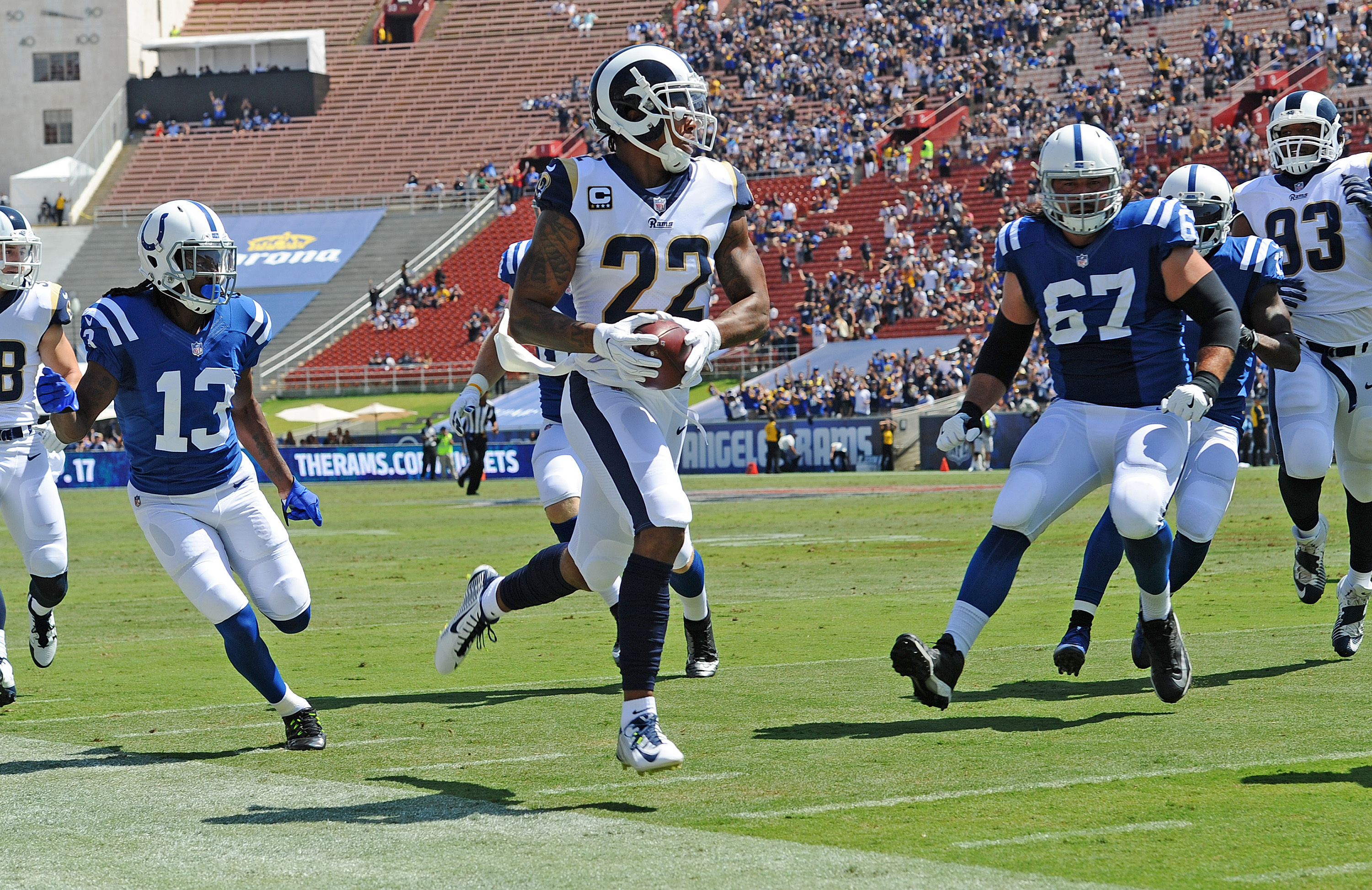 Los Angeles Rams cornerback Trumaine Johnson intercepts a pass for a touchdown in front of Indianapolis Colts receiver T.Y. Hilton (13) in the first quarter on Sunday, Sept. 10, 2017 at the Coliseum in Los Angeles, Calif. (Wally Skalij/Los Angeles Times/TNS)