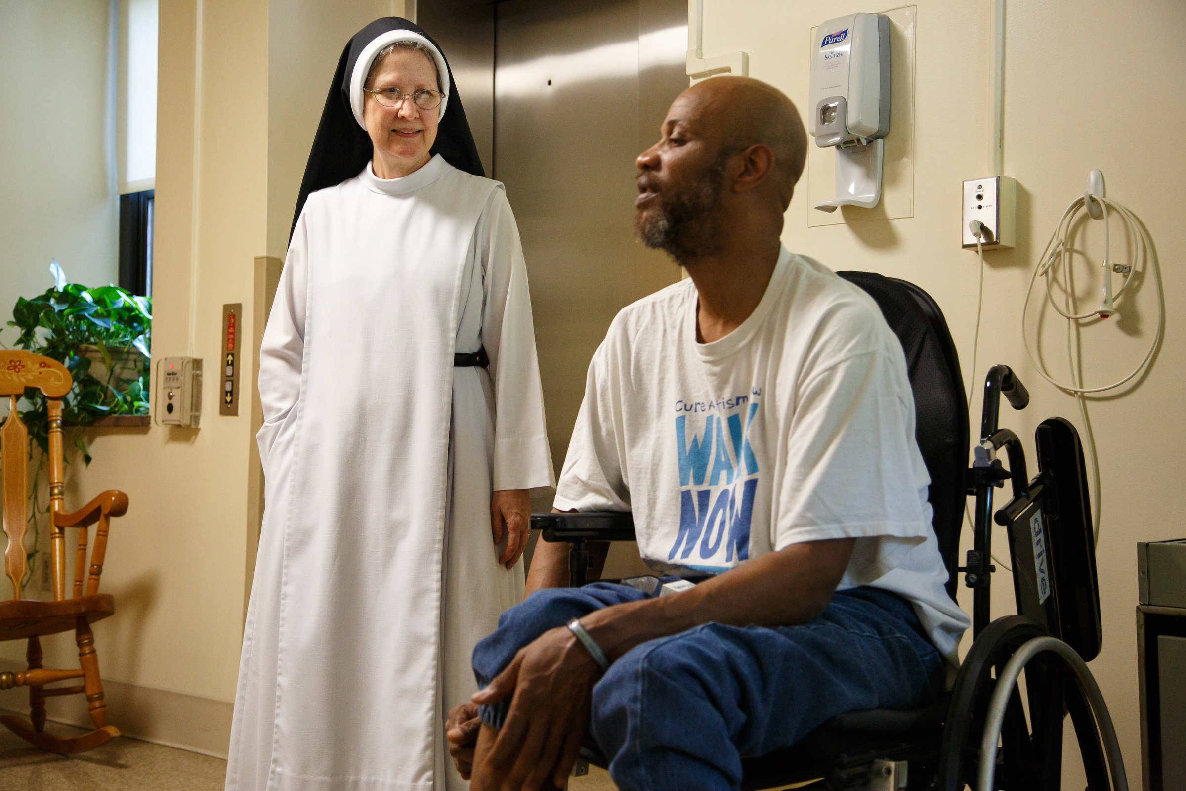 Sister Mary DePaul, left, talks with patient Saleem Muhammed, center, at Sacred Heart Home in Northeast Philadelphia, Monday, Sept. 11, 2017. The nuns take care of terminally ill patients at the Sacred Heart Home. JESSICA GRIFFIN / Staff Photographer