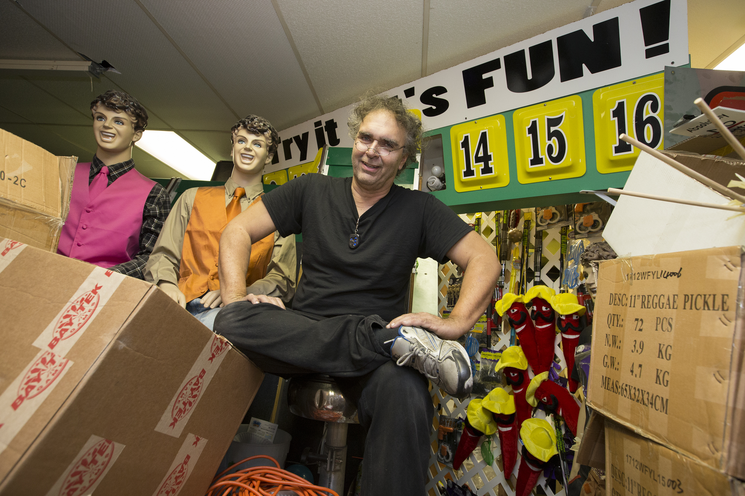 """With the Boardwalk Mall for sale, Randy Senna is not sure he´ll be a part of the future and he´s offering all the contents of his arcade for sale, $700,000 worth of games. He is shown with a few of the """"Randy"""" manaquinns, modeled after himself, in the arcade. CHARLES FOX / Staff Photographer"""