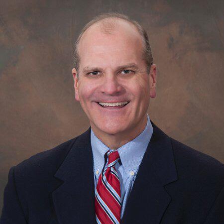 Brian C. Zwaan, helped keep open the doors at Archbishop Carroll High School.