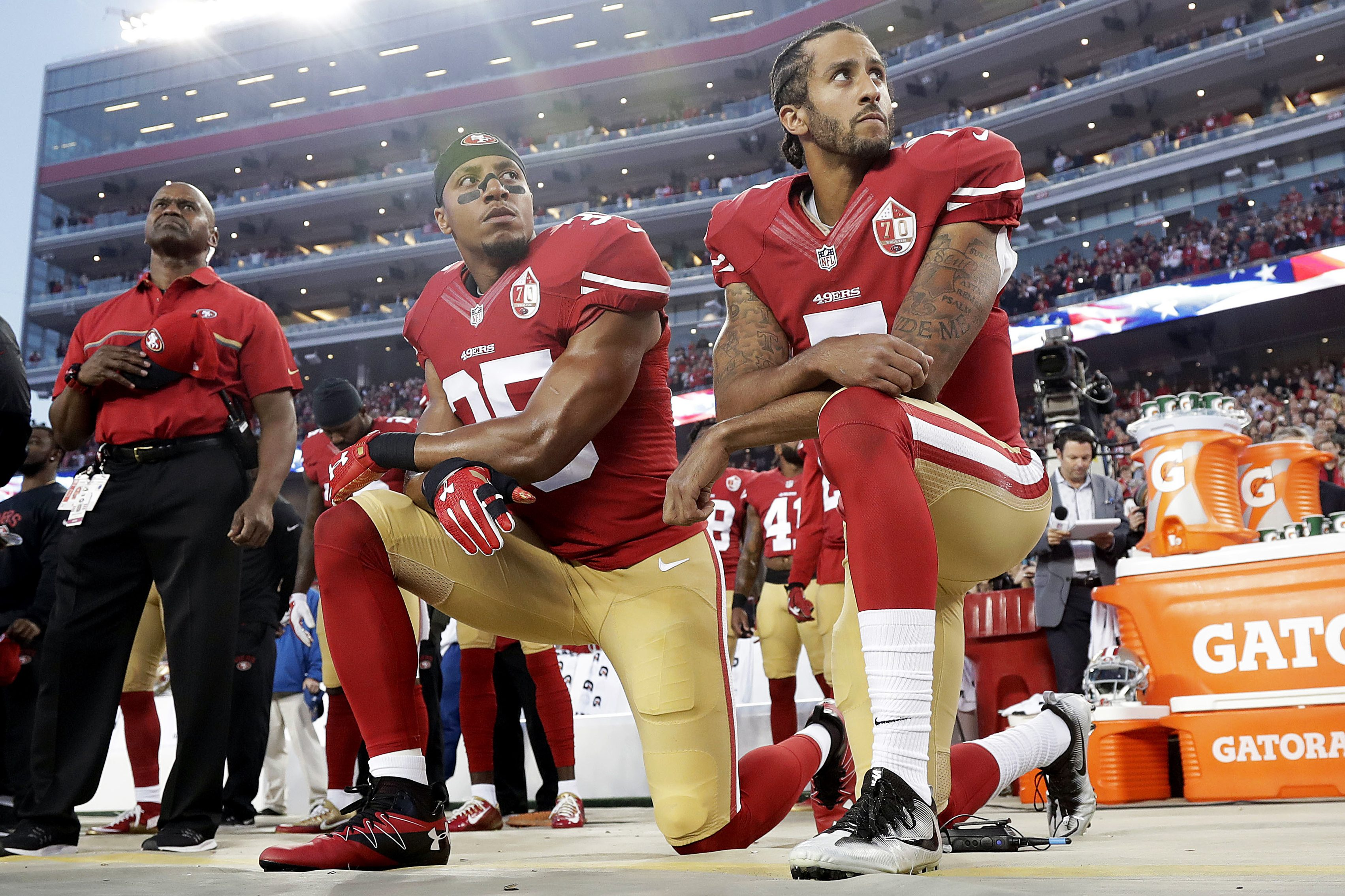 San Francisco 49ers safety Eric Reid (35) and quarterback Colin Kaepernick (7) kneel during the national anthem before an NFL football game against the Los Angeles Rams in 2016.