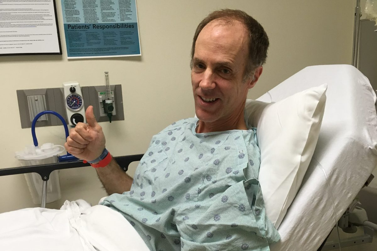 Reporter Tom Avril gives a thumbs-up before his colonoscopy at Holy Redeemer Healthcare's ambulatory surgery center.