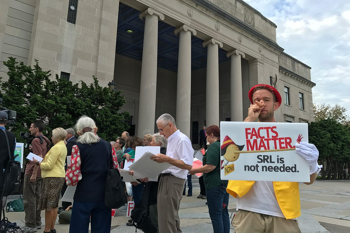 """Opponents of the gas line gathered outside for the vote. Karlos Basak of Freehold dressed as Pinocchio for what he said were the """"lies"""" of some members of the  Pinelands Commission."""