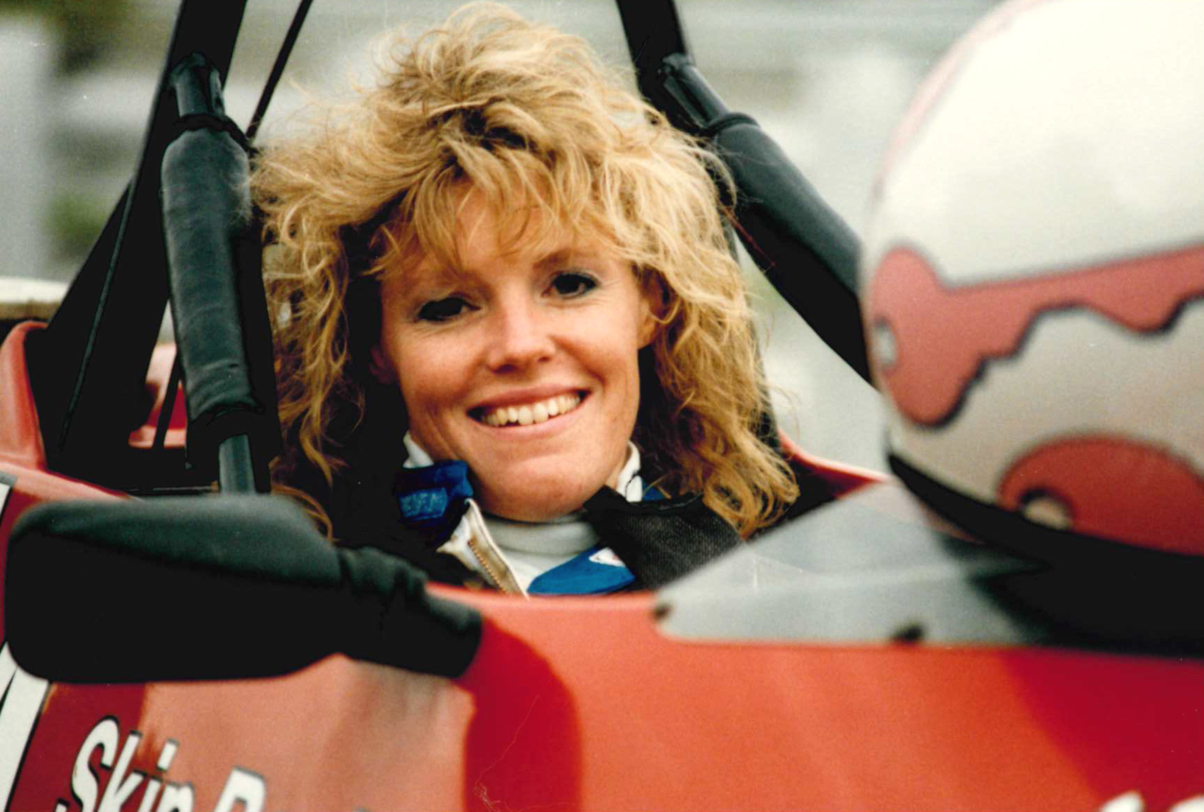 Laura Thompson Barnes, vice president, the Thompson Organization, in 1989 indulging her other passion: racing Formula Fords. This time in Lime Rock, Conn.