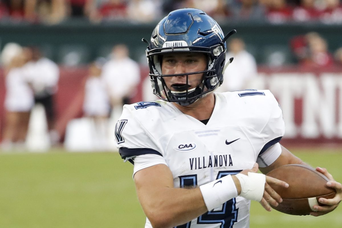Villanova quarterback Zach Bednarczyk runs with the football against Temple.