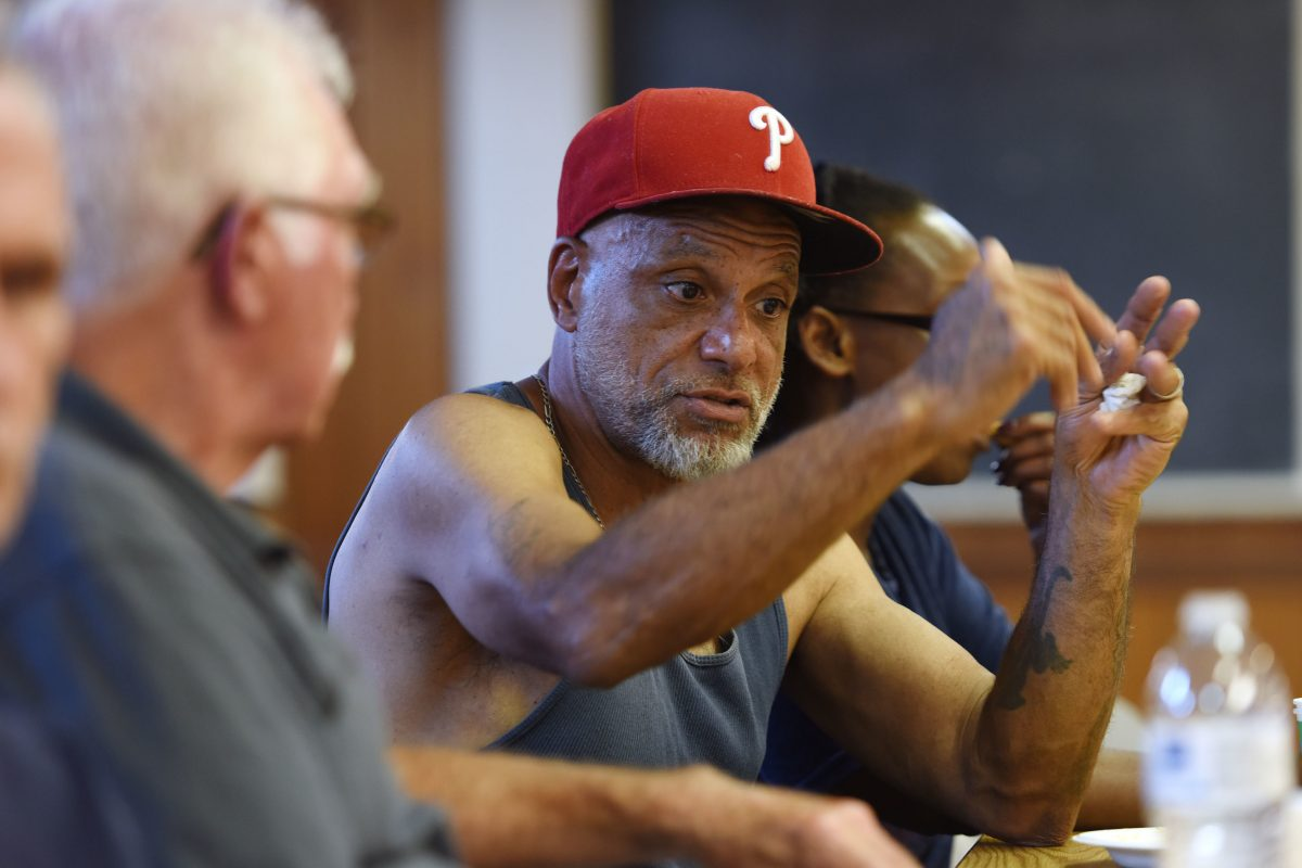 Mentor Jim Paradisi, left, and returning citizen James Jankins, right, talk before a meeting of the Lancaster-Reentry Program at the Ebenezer Baptist church.