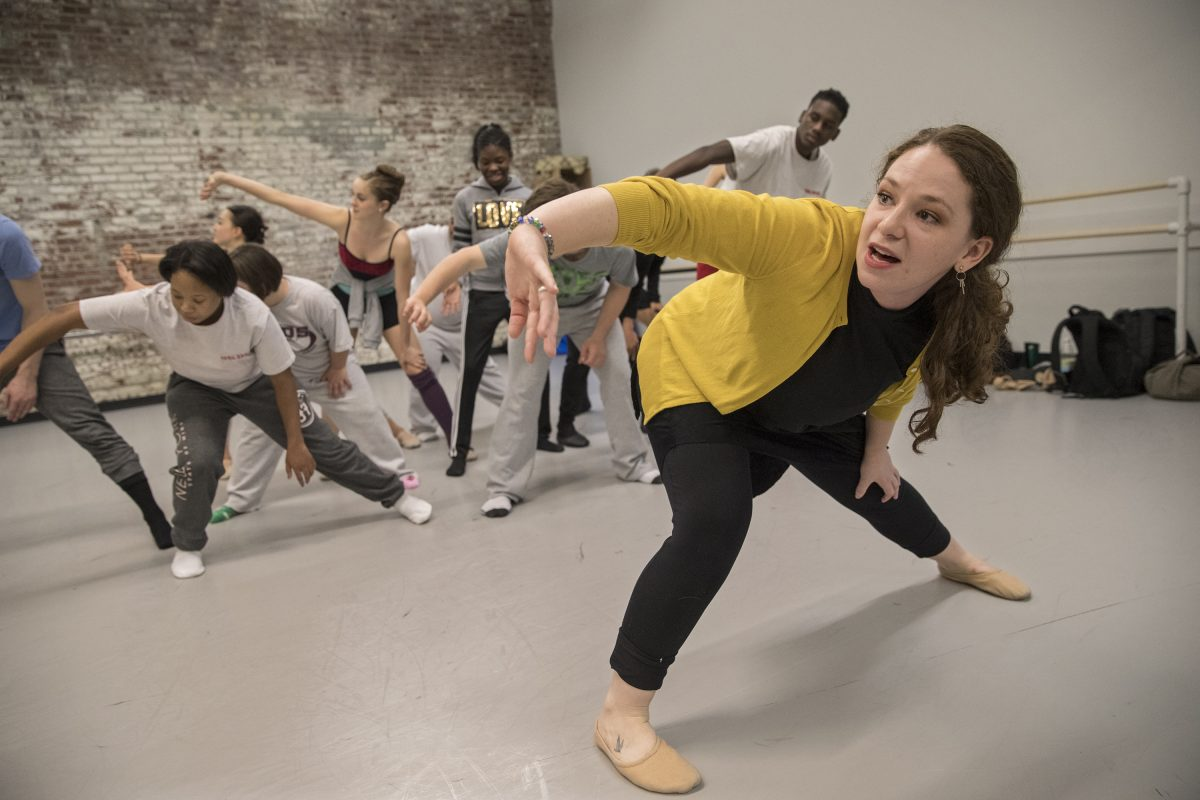 "During rehearsal this spring, choreographer Jessica Kilpatrick, right, shows a combined ensemble of Pennsylvania Ballet II dancers and St. Katherine Day School students  how she wants them to move in their performance of ""I Am."" Their collaboration is the subject of a new documentary."