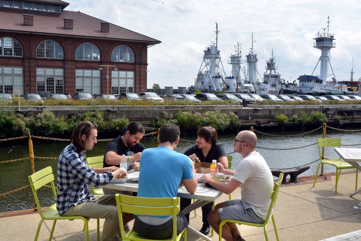 At the Navy Yard in South Philadelphia, a group of employees enjoys lunch outside of Building 543. The location is being highlighted as a potential location for Amazon's corporate headquarters.
