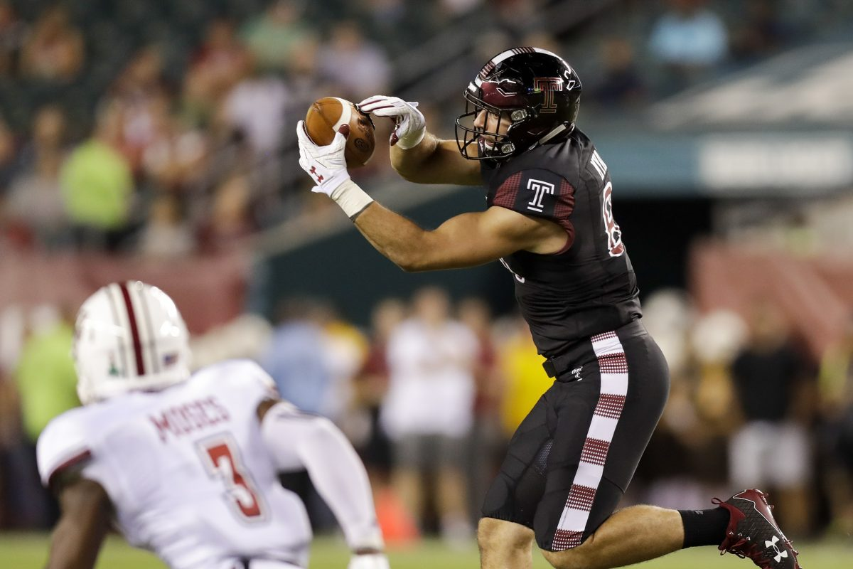 Temple tight end Chris Myarick catches the football against UMass cornerback Lee Moses during the second-quarter on Friday, September 15, 2017 in Philadelphia. YONG KIM / Staff Photographer