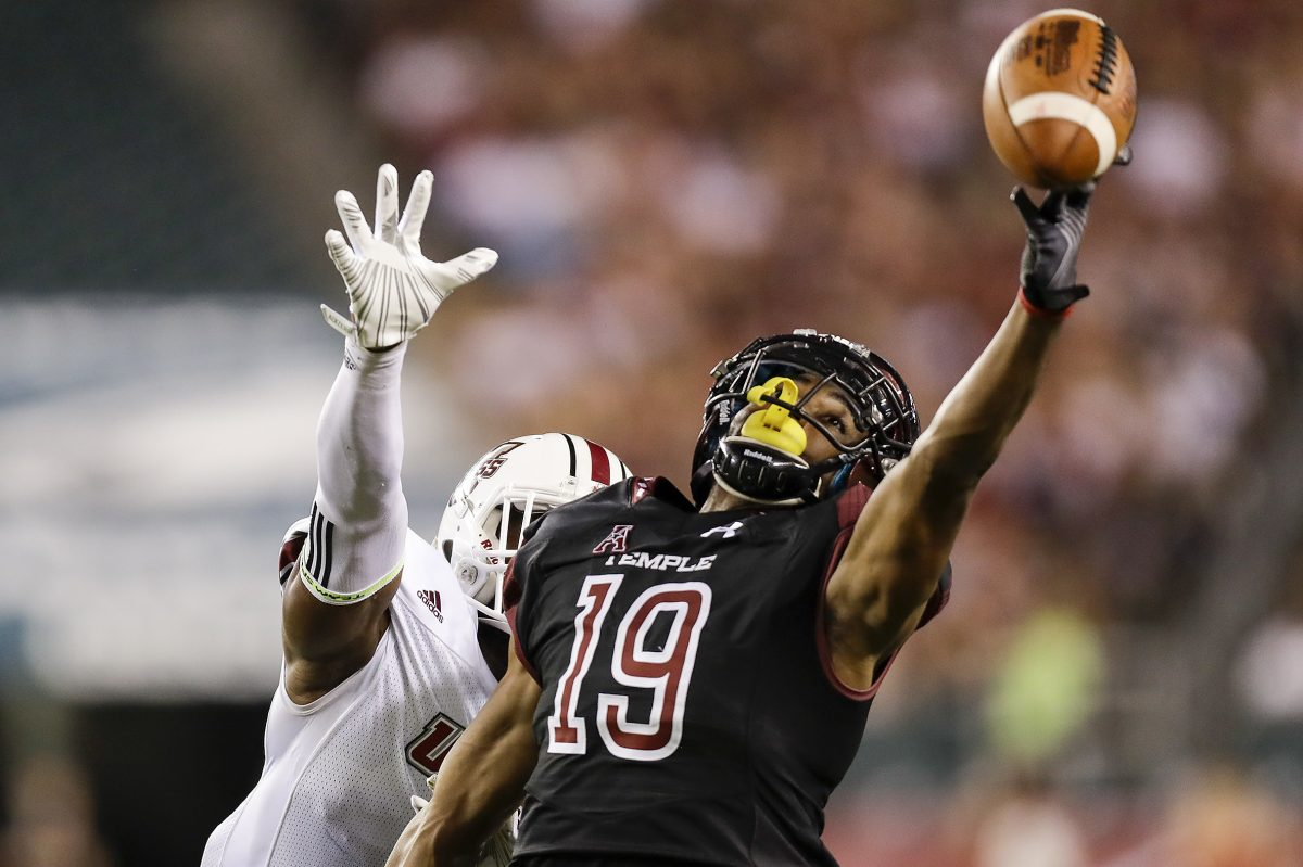 Temple wide receiver Ventell Bryant attempts to catch the football against UMass cornerback Lee Moses during the first-quarter on Friday, September 15, 2017 in Philadelphia. YONG KIM / Staff Photographer