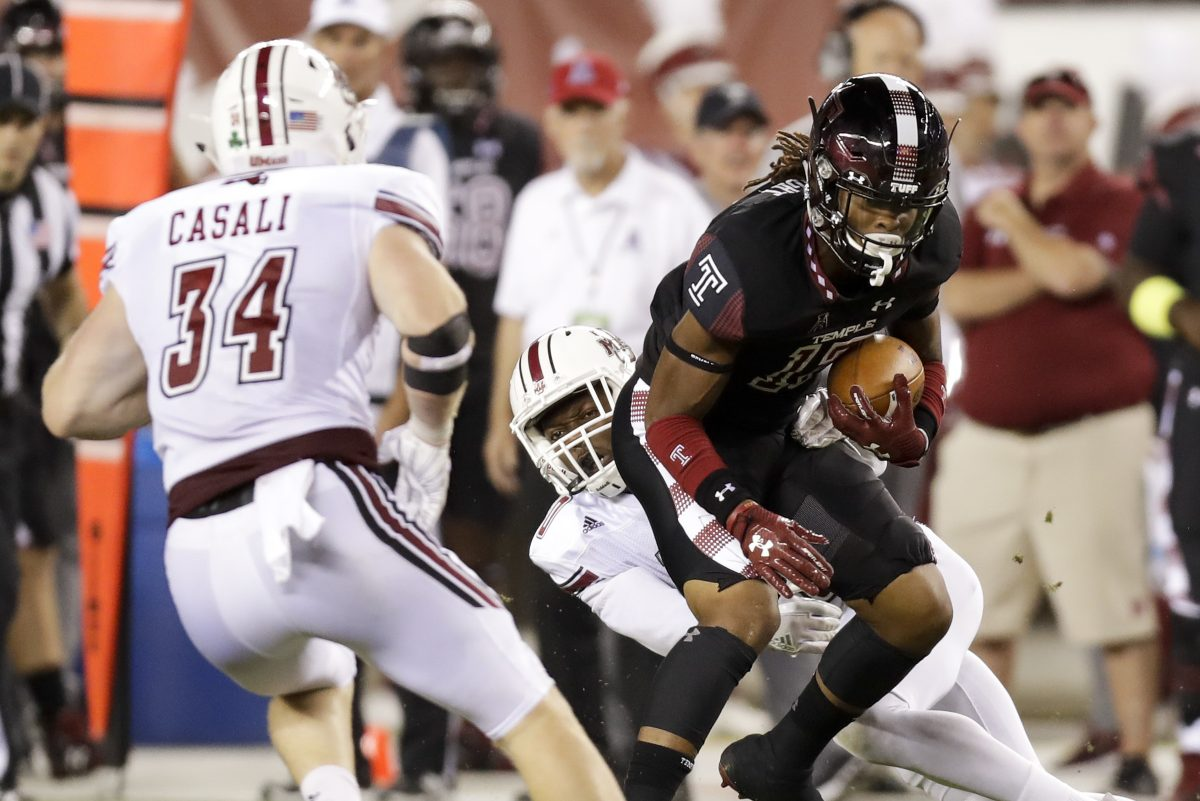 Temple wide receiver Isaiah Wright runs with the football past UMass safety Tyler Hayes (center) and linebacker Steve Casali (left) during the second-quarter on Friday, September 15, 2017 in Philadelphia. YONG KIM / Staff Photographer