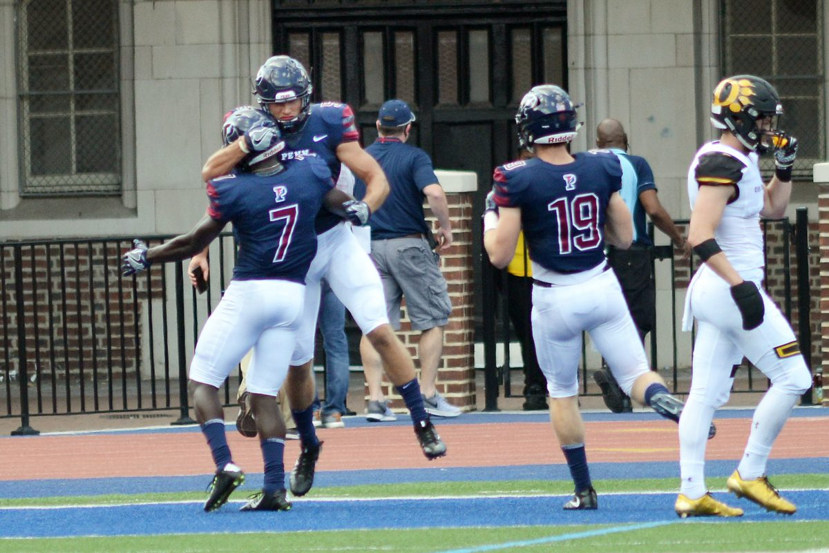Christian Pearson (7) and Justin Watson (5) celebrate a touchdown in the second quarter of Penn's 42-24 win on Saturday.