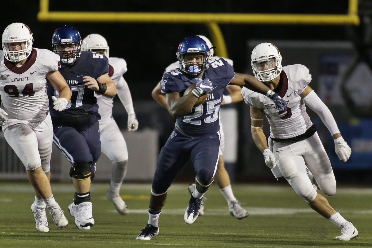 Villanova's Aaron Forbes breaks away from the pack for a 29 yard gain in the 3rd quarter of the Wildcats' 59-0 win over Lafayette.