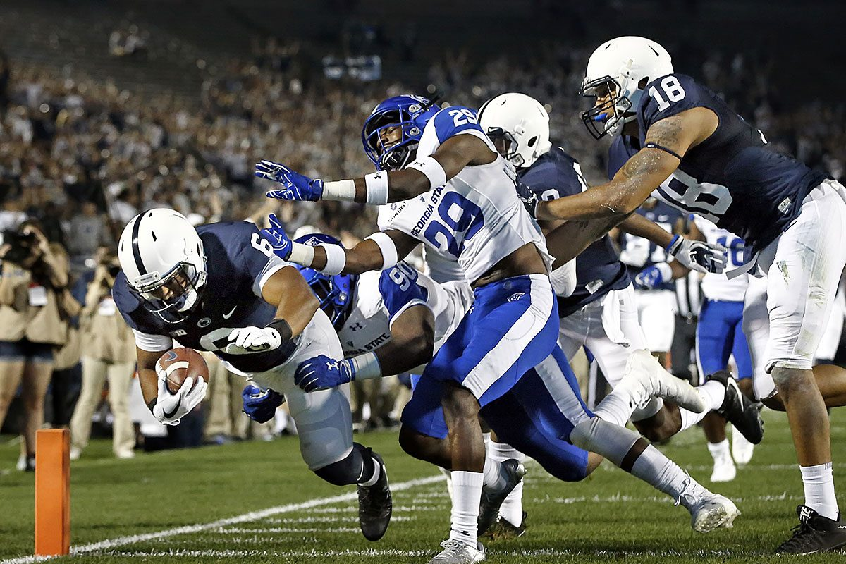 Penn State's Andre Robinson (6) dives for a touchdown against Georgia State during the second half of an NCAA college football game in State College, Pa., Saturday, Sept. 16, 2017. Penn State won 56-0.