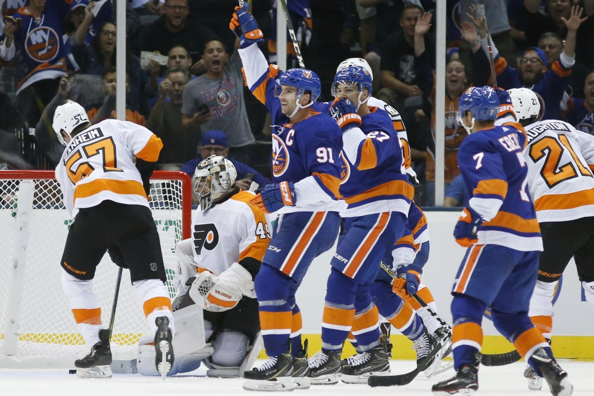 Islanders center John Tavares (91) celebrates after scoring against Flyers goalie Alex Lyon  in the second period