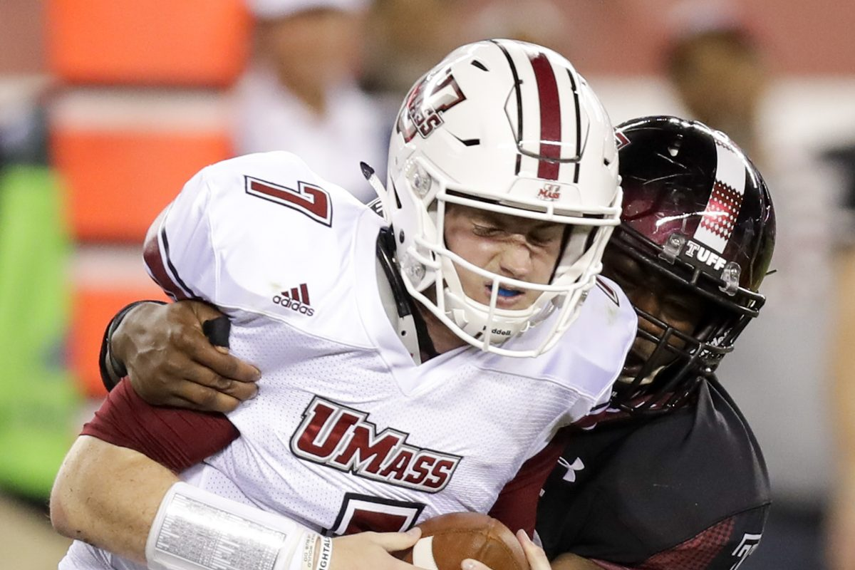 Temple defensive lineman Quincy Roche sacks UMass quarterback Andrew Ford during the first quarter Friday.