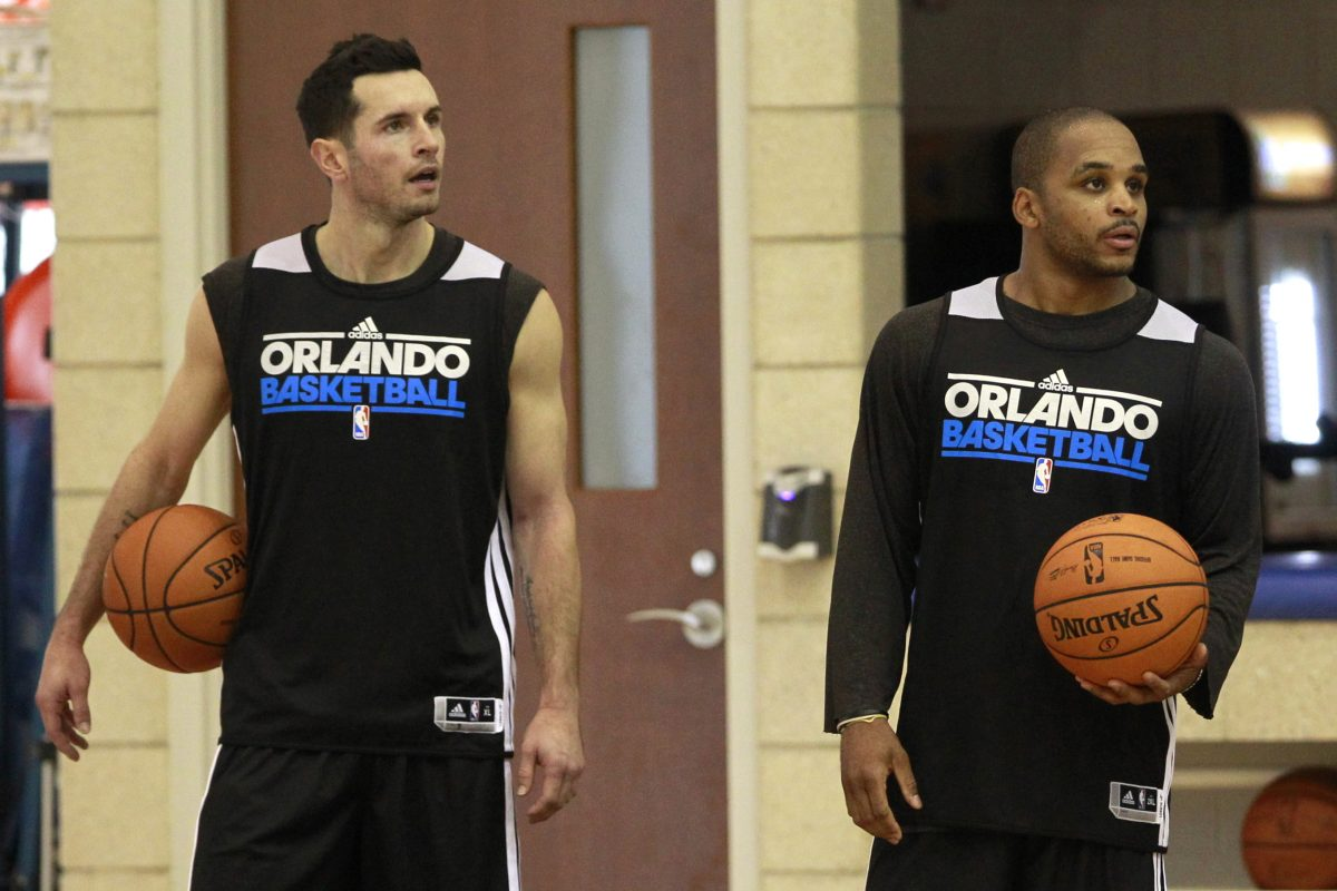 The Orlando Magic's J.J. Redick (left) and Jameer Nelson listen to head coach Jacque Vaughn during training camp in October 2012.