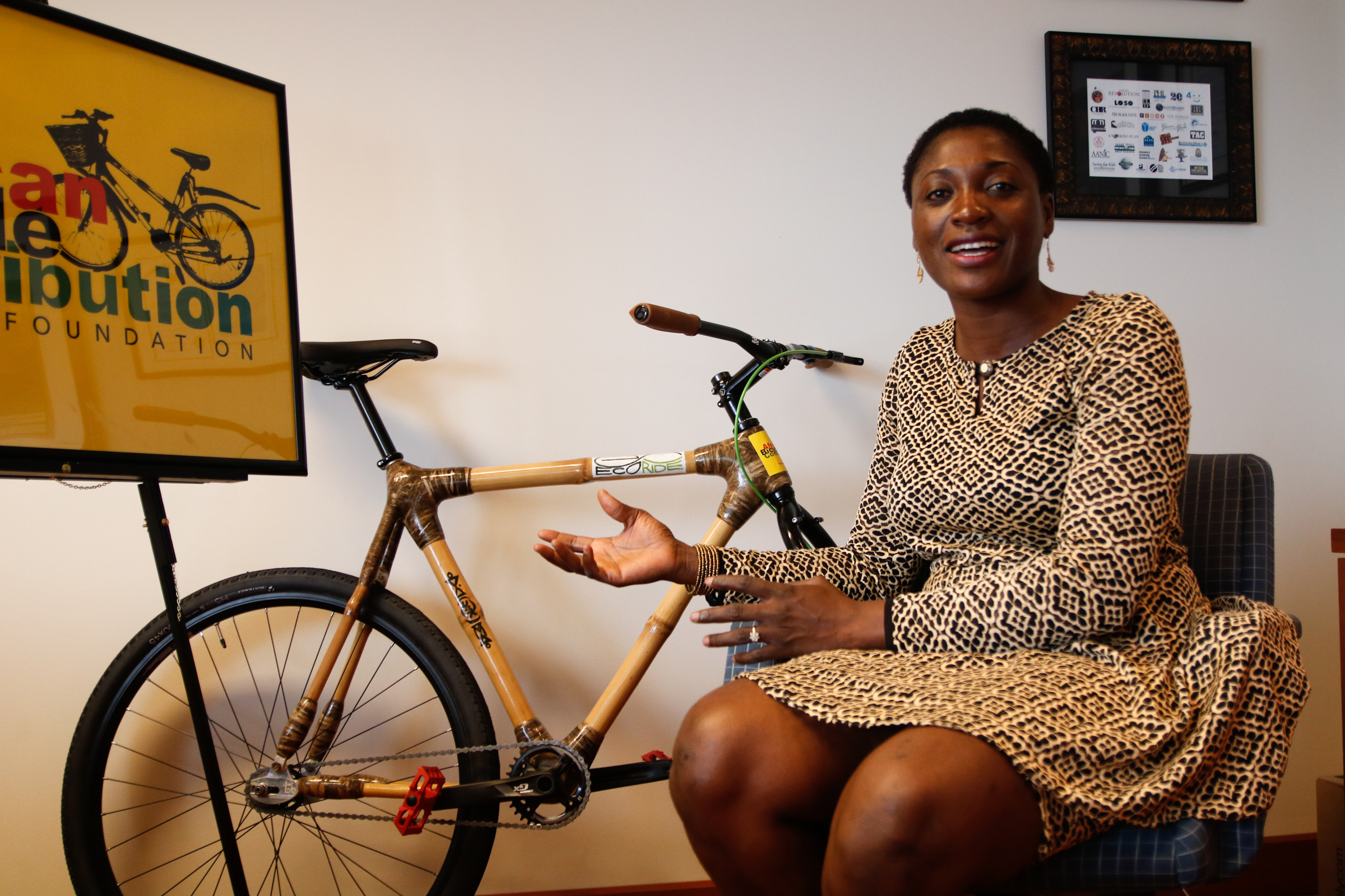 Bernice Dapaah, the founder of Bamboo Bike Initiative, an organization based in Ghana that distributes free bamboo bicycles for transport-dependent students and rural farmers in Ghana explains the materials used to make the bikes on Monday morning, September 18, 2017. KAIT MOORE / Staff Photographer