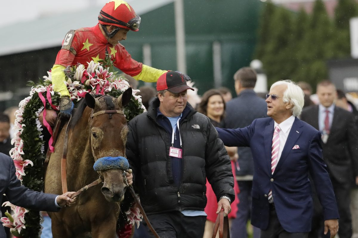 Trainer Bob Baffert (right) with horse Abel Tasman after victory in the Kentucky Oaks in May.