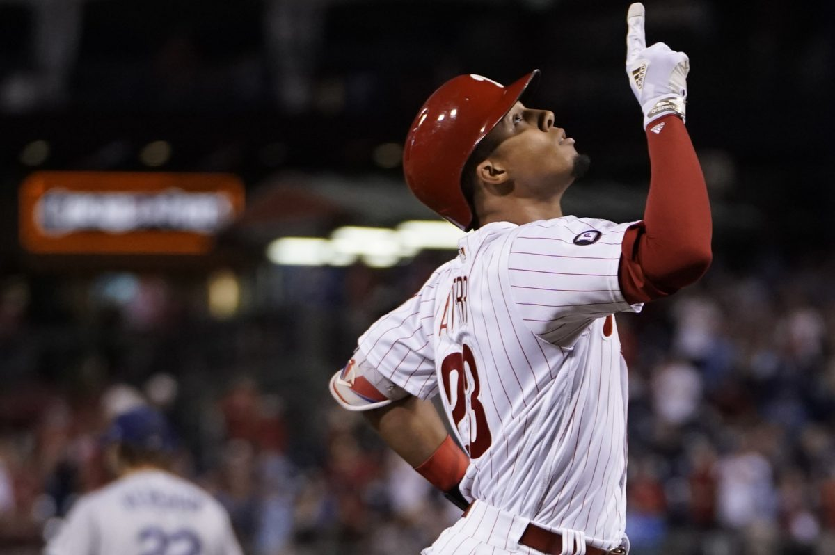 Phillies outfielder Aaron Altherr celebrates his grand slam in the sixth inning off Dodgers pitcher Clayton Kershaw.