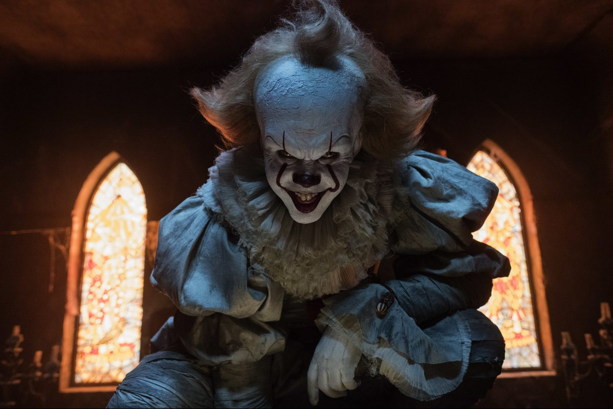 "Bill Skarsgard as Pennywise in a scene from ""It."""