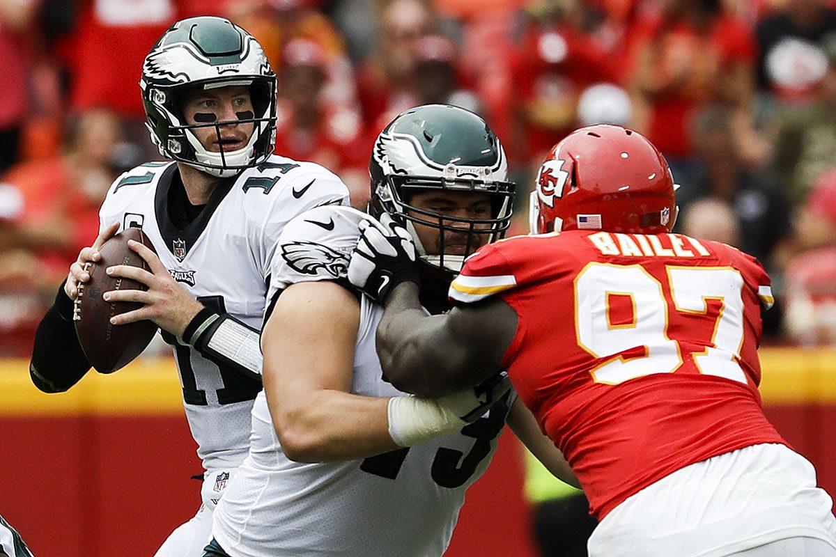 Eagles quarterback Carson Wentz throws the football as offensive guard Isaac Seumalo blocks Kansas City Chiefs defensive end Allen Bailey.