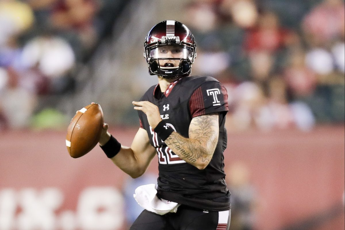 Temple quarterback Logan Marchi runs with the football against UMass.