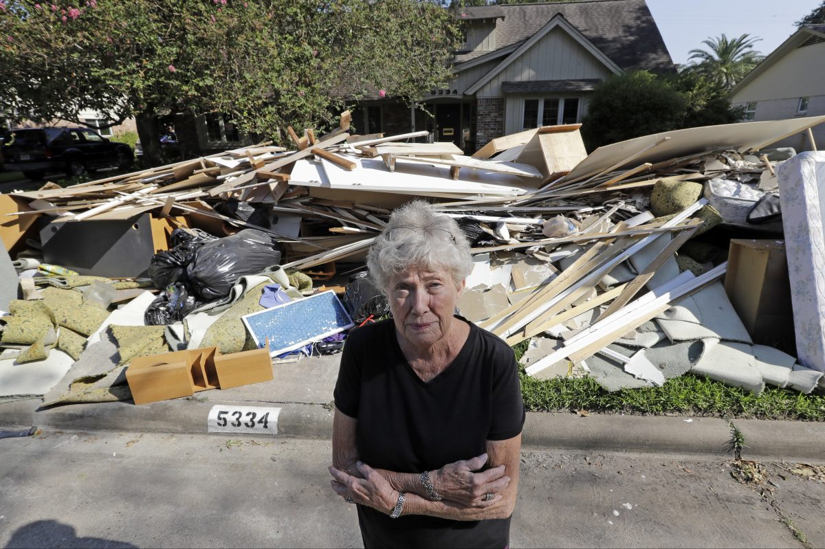 Arlene Estle outside her Houston home, which was damaged by flood waters from Hurricane Harvey.
