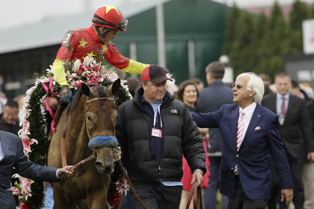 Bob Baffert (right) celebrates with jockey Mike Smith after Smith rode Abel Tasman to victory in the Kentucky Oaks in May.