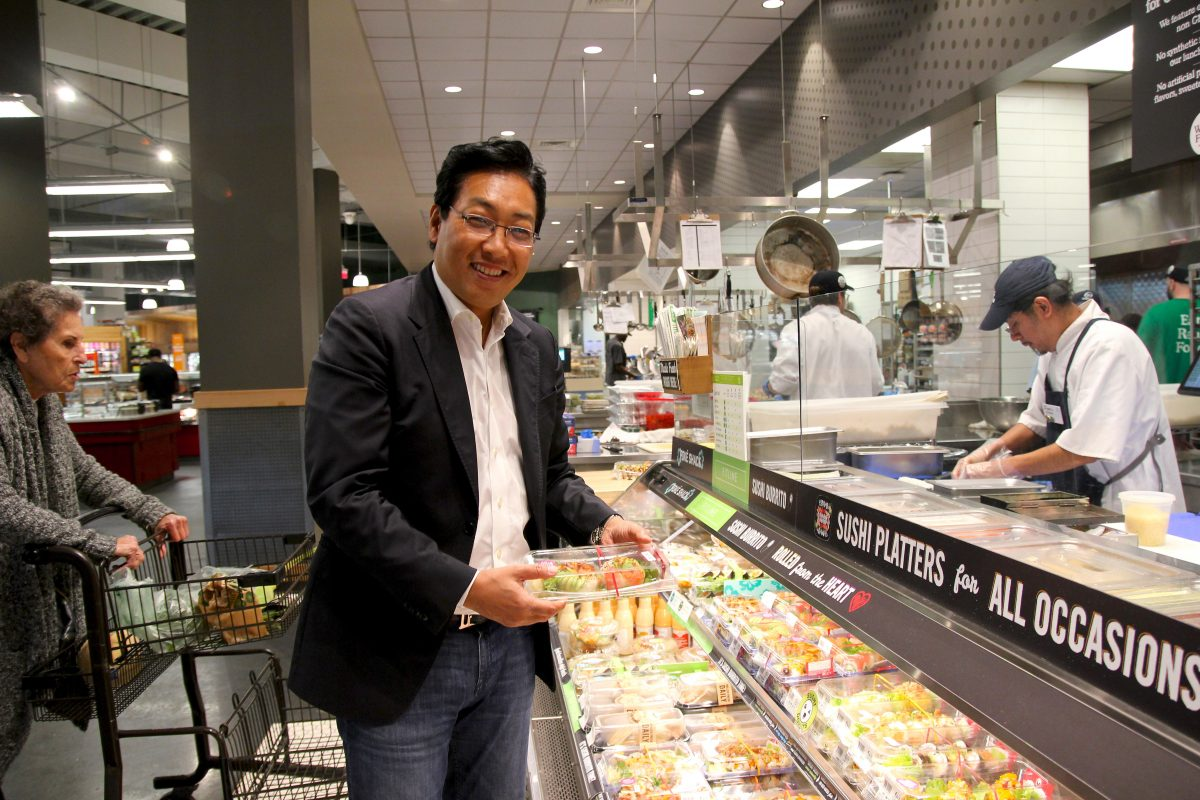 Josh Onishi, chief executive of Peace Dining, at the Genji sushi case at the Whole Foods Market on Callowhill Street.