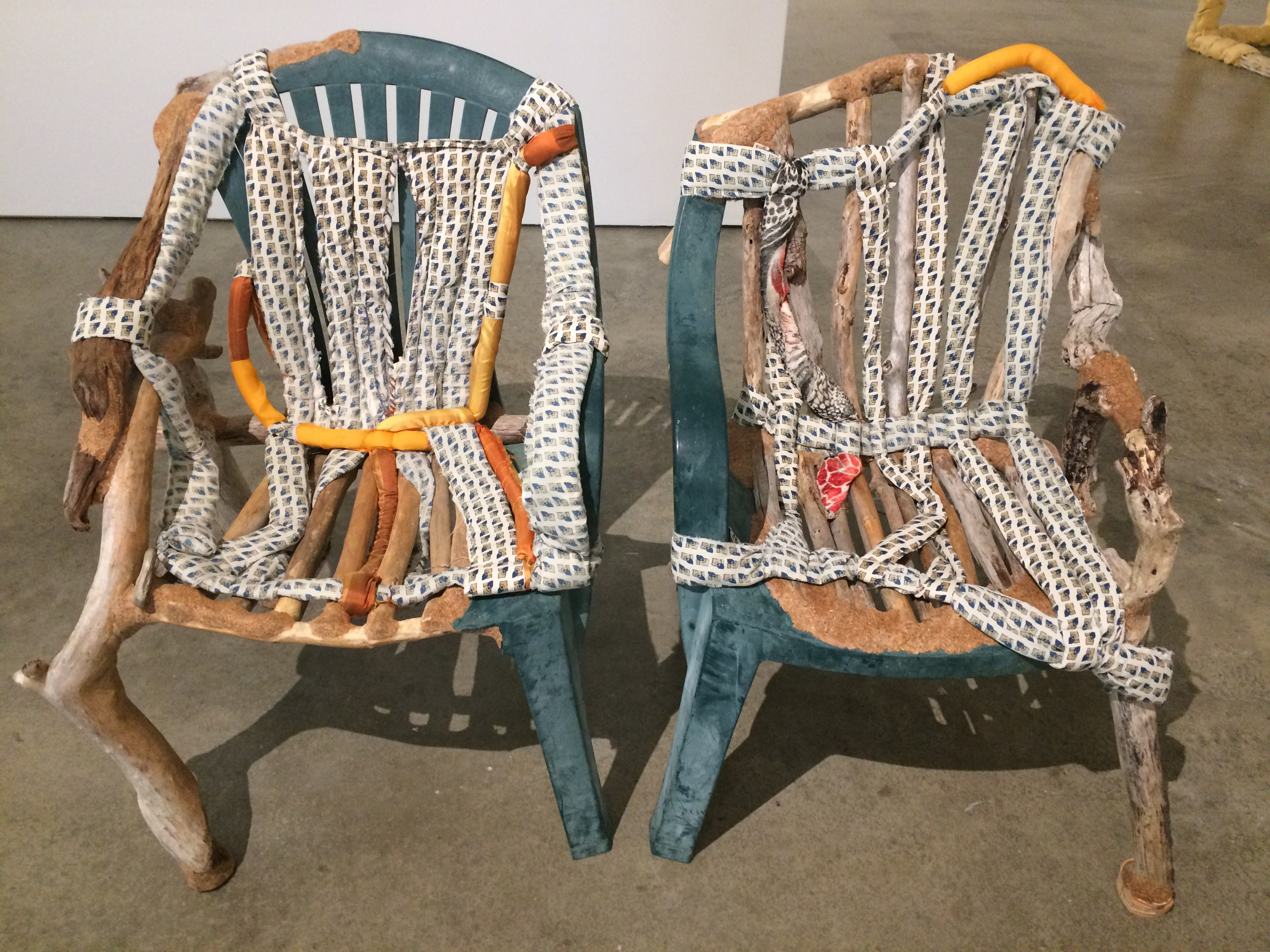 "Jessi Reaves' ""Chair 1"" and ""Chair 2"" (both from 2016), plastic, driftwood, sawdust, wood glue, fabric, cotton batting, and polyurethane foam, at the ICA"