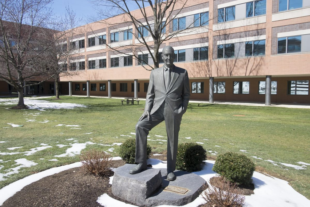 A statue of Vanguard founder Jack Bogle in a courtyard on the company's Malvern campus.