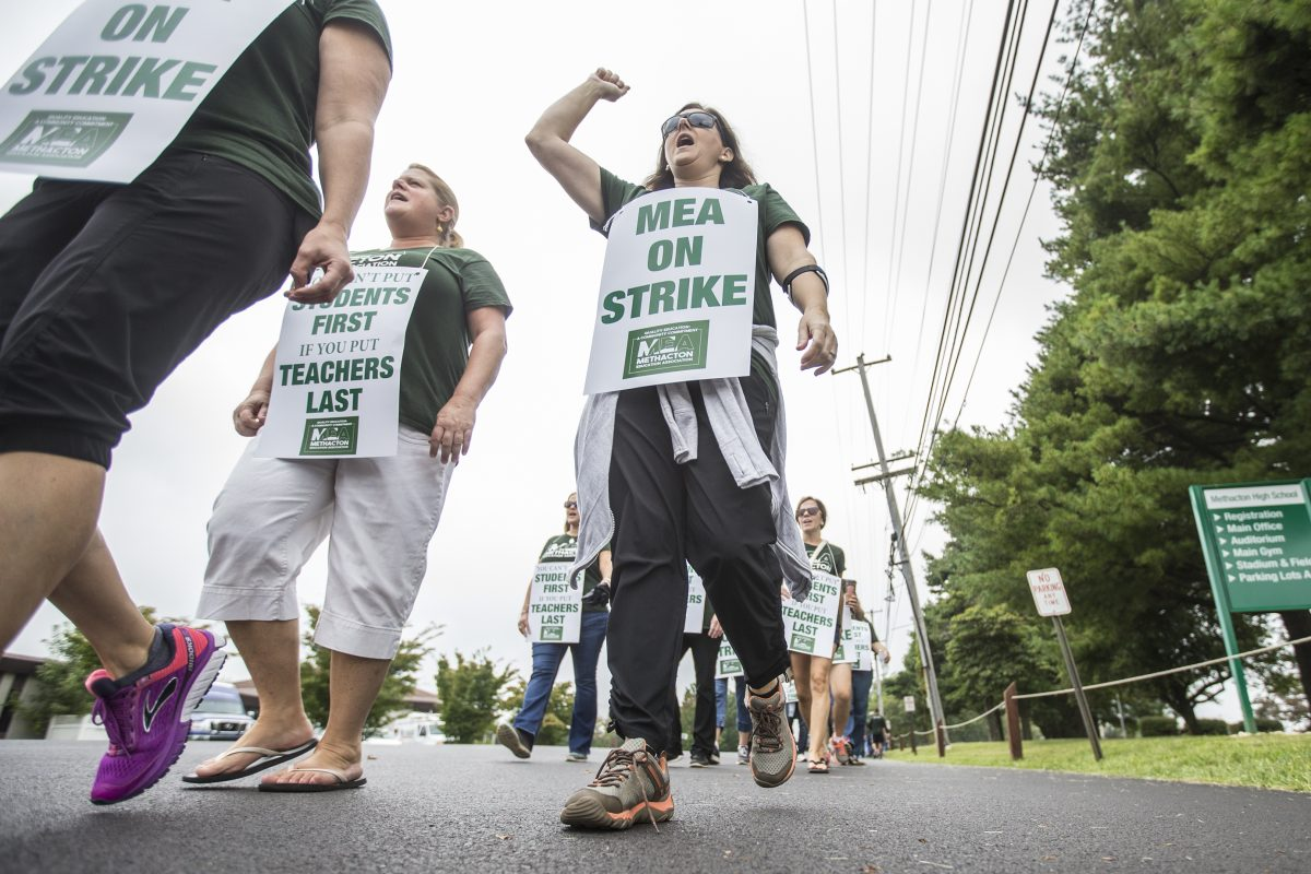 Teachers, counselors, librarians, speech therapist and other members of the Methacton Eduction Association march the picket line in front of the Methacton School District office in Eagleville, PA on Monday September 18, 2017.