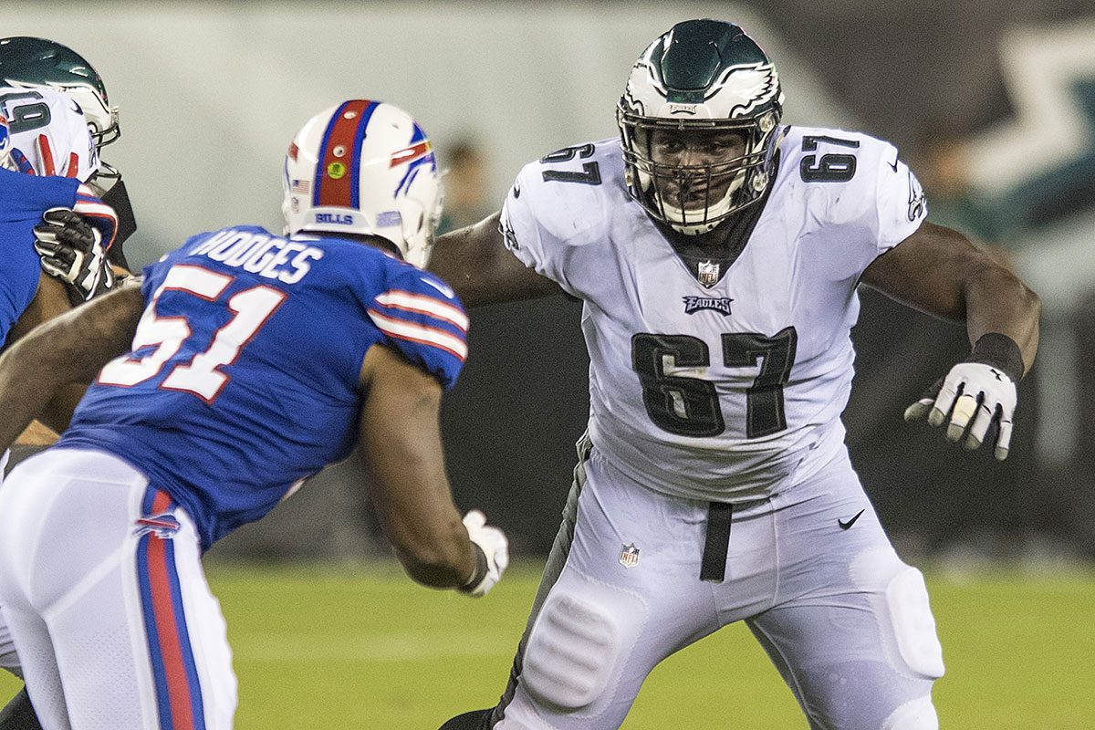 Eagles guard Chance Warmack prepares to make a block in a preseason game against the Bills.