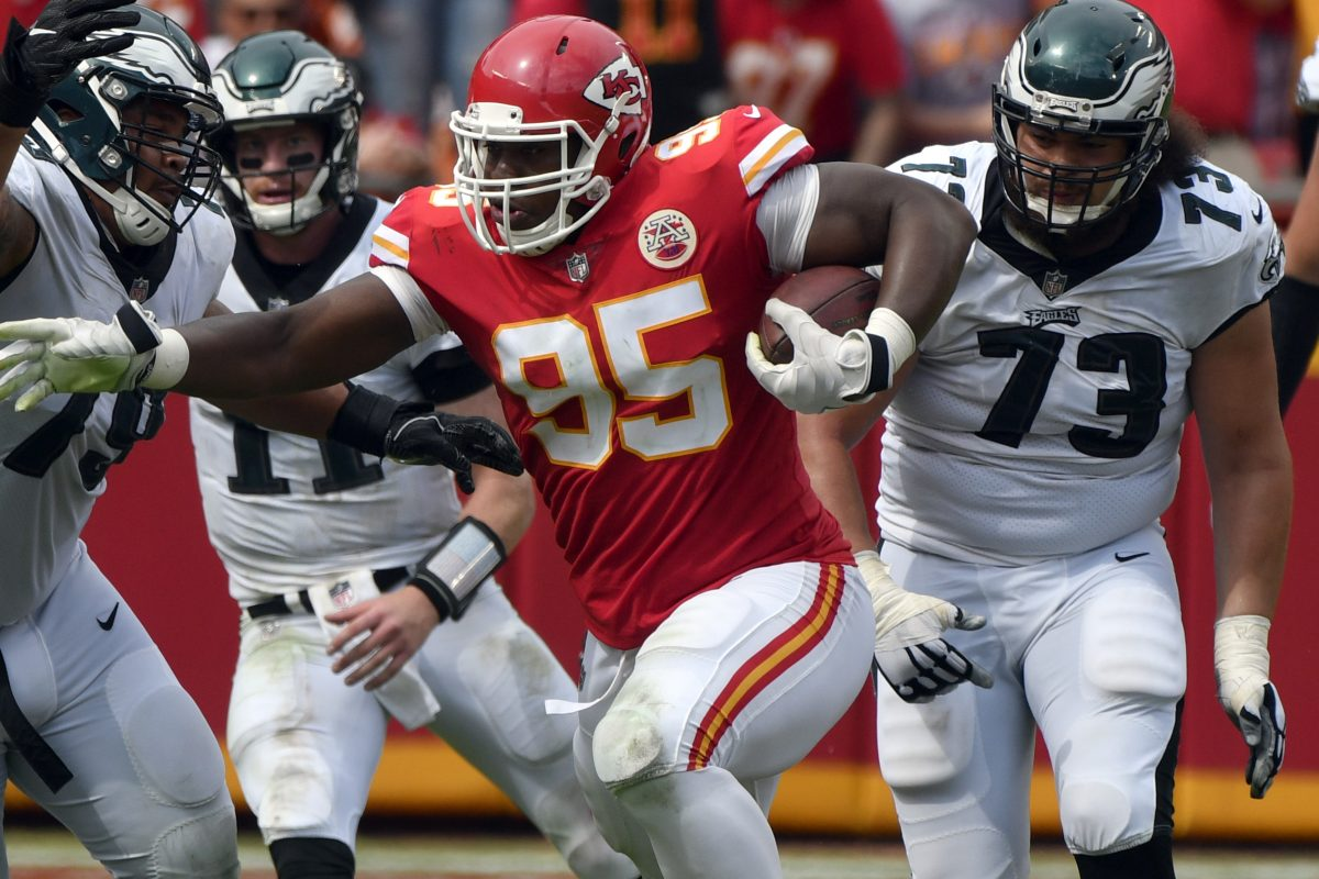 Kansas City Chiefs defensive lineman Chris Jones (95) is flanked by Philadelphia Eagles offensive guard Brandon Brooks (79) and offensive guard Isaac Seumalo (73) catching a deflected pass from Philadelphia Eagles quarterback Carson Wentz for a turnover, during the second half of an NFL football game in Kansas City, Mo., Sunday, Sept. 17, 2017. (AP Photo/Ed Zurga)