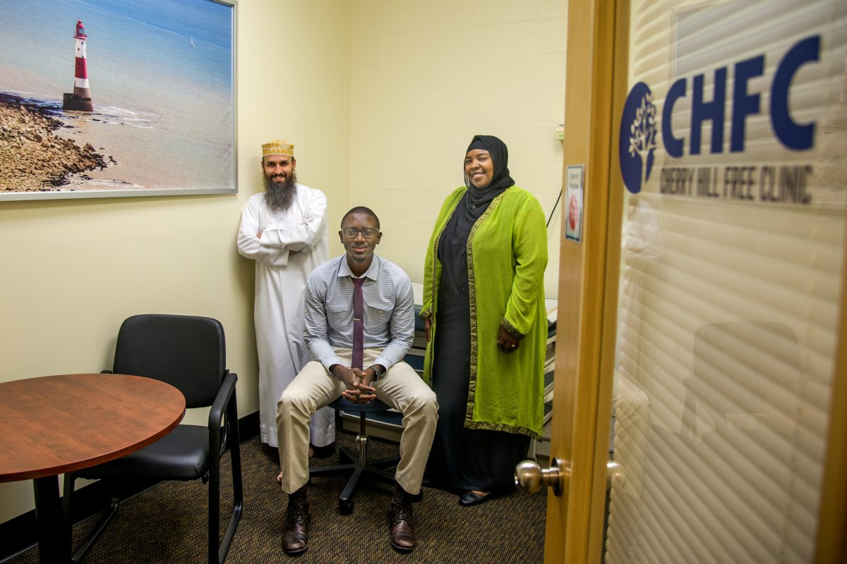 In an examination room are (from left) John Starling, mosque executive director; Jubril Oyeyemi, clinic medical director; and Rashidah Khalifa, operations manager.