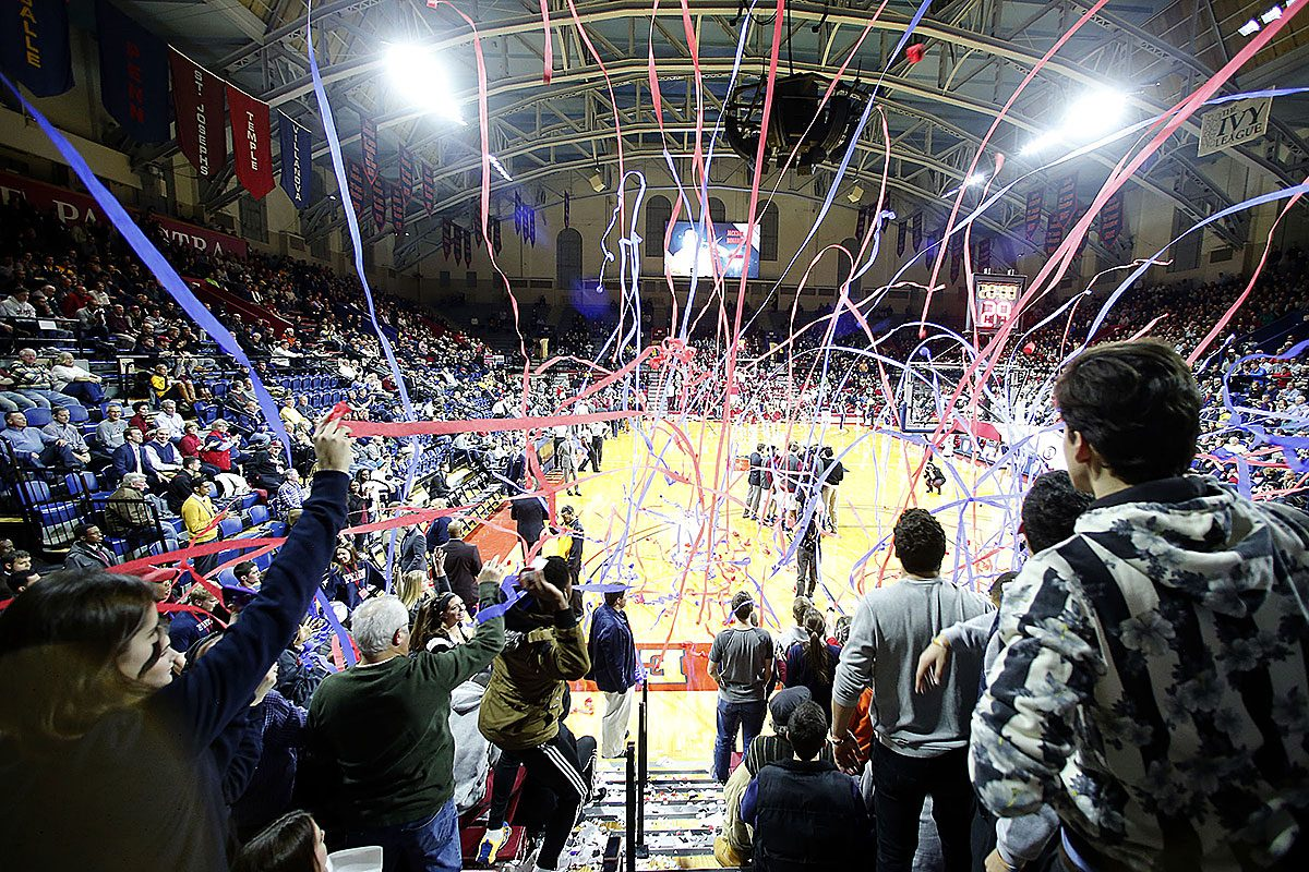 Penn students throw streamers on the court before Penn played Saint Joseph's at the Palestra in January of 2016.
