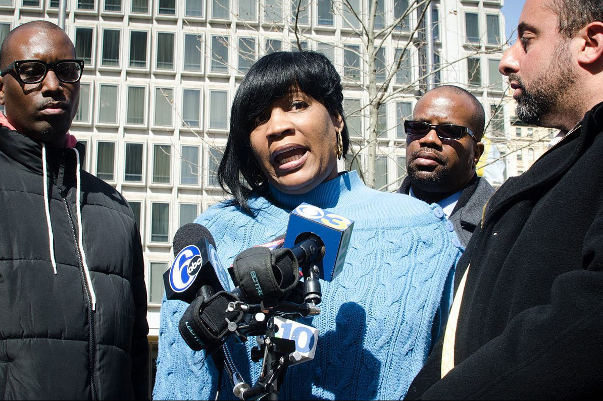 FILE PHOTO – Tanya Brown-Dickerson, mother of Brandon Tate-Brown speaks to reporters in March 2015 after receiving news that the officers involved in the shooting will not be charged in his death. With her are Asa Khalif, Tate-Brown´s cousin (left); and Brian Mildenberg, attorney (far right). ( Meaghan Pogue / STAFF PHOTOGRAPHER )