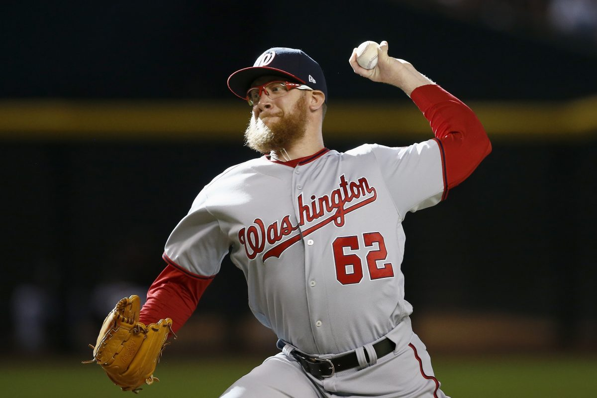 Washington Nationals´ Sean Doolittle throws a pitch against the Arizona Diamondbacks during the ninth inning of a baseball game Sunday, July 23, 2017, in Phoenix. The Nationals defeated the Diamondbacks 6-2. (AP Photo/Ross D. Franklin)