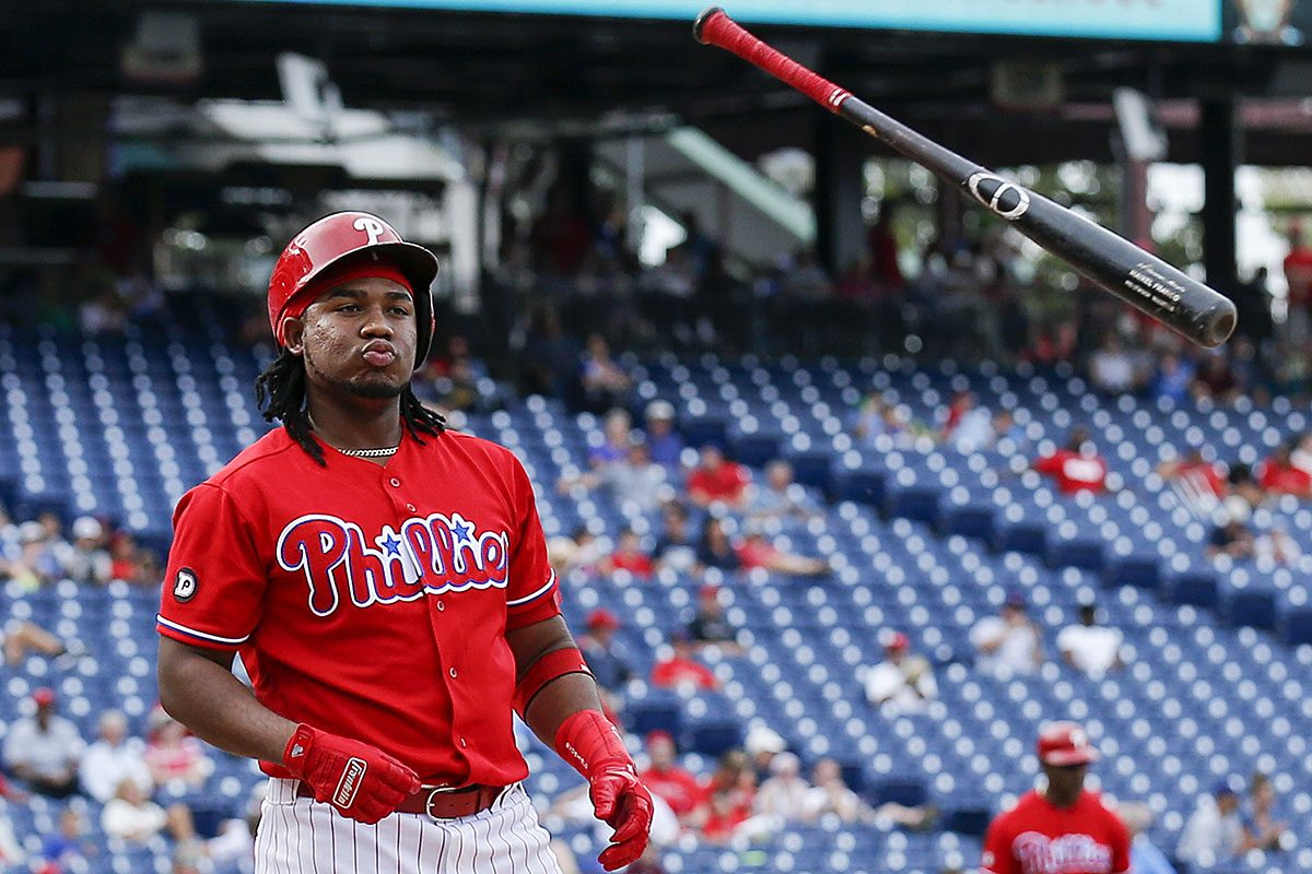 Maikel Franco tosses his bat after striking out to end the eighth inning against the Los Angeles Dodgers.