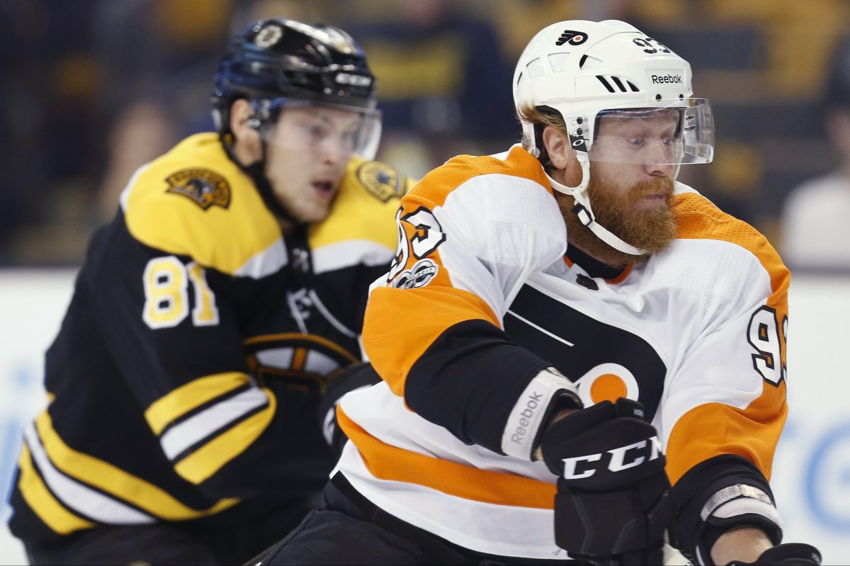 Anton Blidh  of the Bruins defends against Jake  Voracek during the first period.