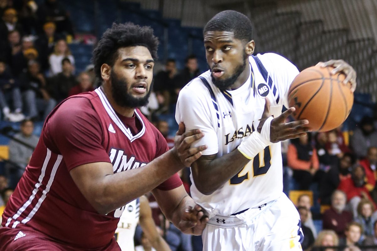 La Salle's B.J. Johnson (right) returns this season after being the Explorers' leading scorer last season.