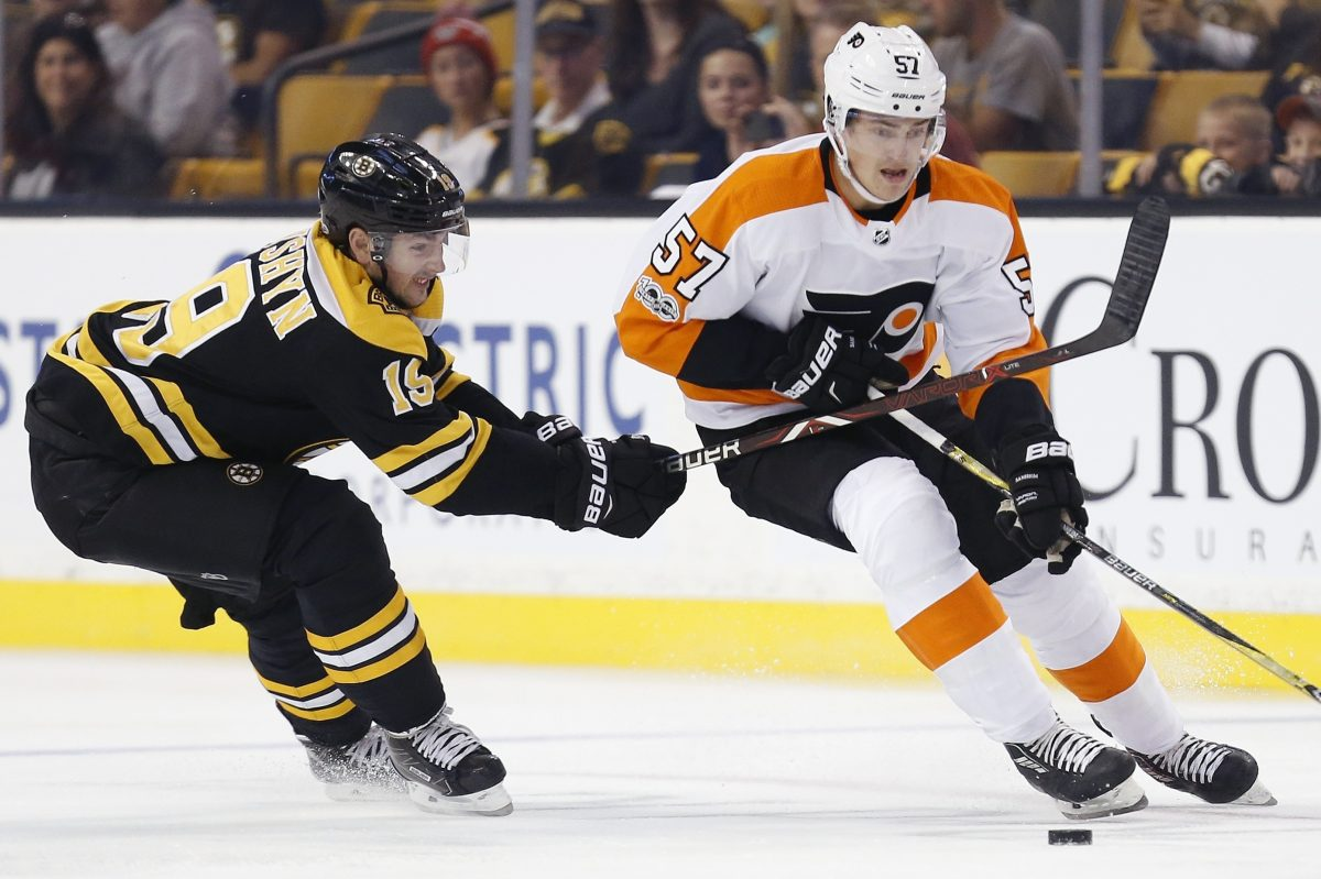 Travis Sanheim (right) skates past Boston's Zachary Senyshyn during the first period of Thursday's preseason game.