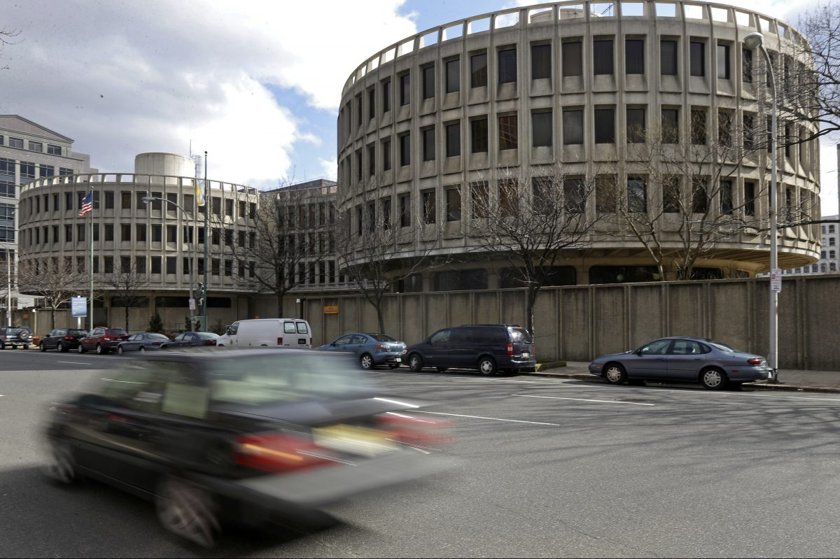 A car drives past the Philadelphia Police Department's headquarters.