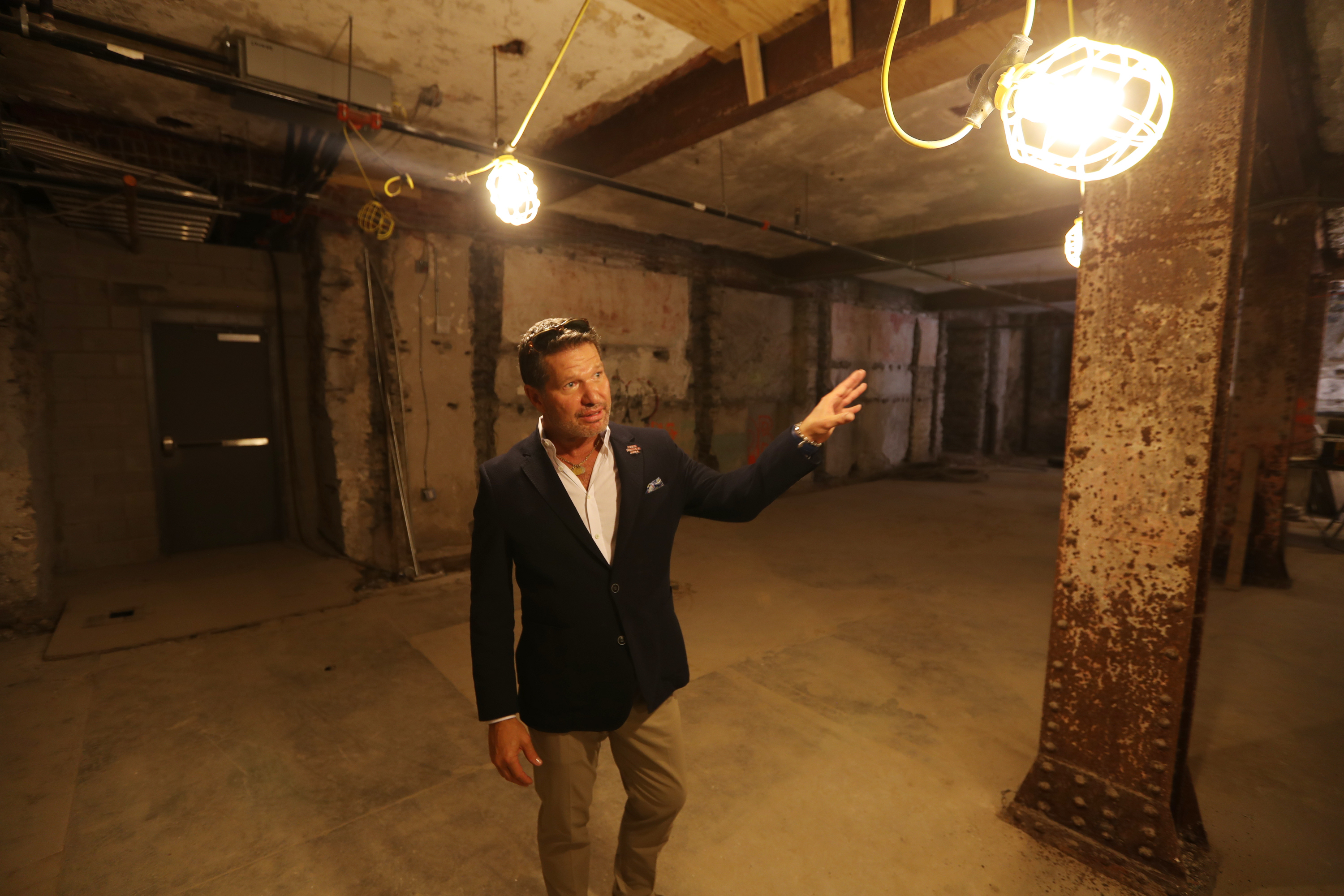 Developer Eric Blumenfeld stands in basement of the Divine Lorraine. Multiple commercial businesses are planned for this area, including a recording studio, a lounge, and a speakeasy.